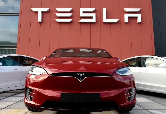 buy Tesla with Bitcoin