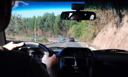 car driving down country road