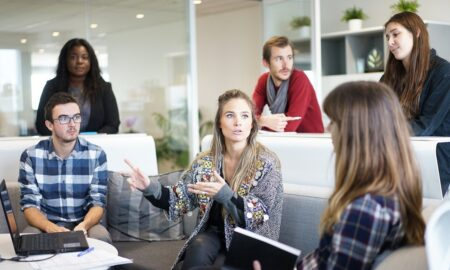 Mylo Kaye - group of employees meeting